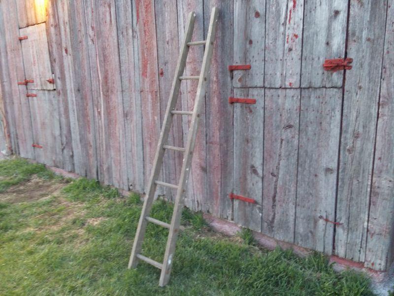 ladder against barn